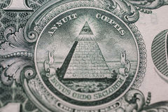 All-seeing eye, truncated pyramid closeup. Money background ,one dollar bill down back reverse side, background of dollars, close up, America royalty free stock photography