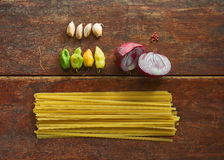 All Set for Spaghetti. A few basic homegrown ingredients for the making of spaghetti Stock Photo