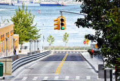 All Signals Go. A traffic light at a downhill intersection going towards the Staten Island ferry Stock Image