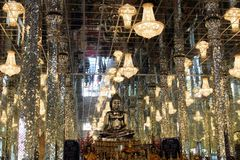 All Silver Temple in Wat Muang, Thailand. Wat Muang contains a silver and sparkly buddhist temple in Ang Thong, Thailand. Sparkling pillars and chandeliers and stock photos