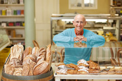 All smiles and freshly baked bread Royalty Free Stock Photo