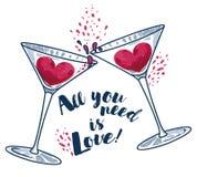 All ` som du behöver, är förälskelse`-affischen med två martini exponeringsglas och hjärtor Royaltyfri Bild