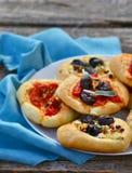 All sorts of mini pizzas. Italian cuisine Stock Photos
