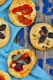 All sorts of mini pizzas. Italian cuisine Royalty Free Stock Image