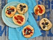 All sorts of mini pizzas. Italian cuisine Royalty Free Stock Photography