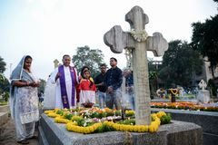 People gather to celebrate All Souls Day in Kolkata. All Souls' Day is a day when Christians remember their family, friends & relatives, who have passed stock image