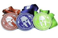All spartan race medals - sprint super and beast. Medals stock photography