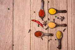 All spice powder and herb. On the wooden table royalty free stock photo