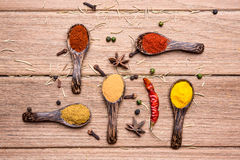 All spice powder and herbs. On the wooden table royalty free stock photo
