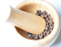 All-spice in a wooden mortar. All-spice (Jamaica pepper) in a mortar stock photography