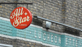 All Star Bowling Lanes London. Brickwork and signage at All Star Bowling Lanes in Brick Lane London Royalty Free Stock Photo