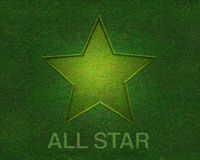 All star on green grass texture Stock Photo