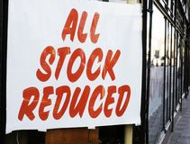 All stock reduced sign. In red lettering in a shop window Royalty Free Stock Photography