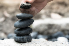 All the successful have a good support,  zen stone, balance, rock, peaceful concept Stock Photos