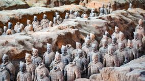 Terra-cotta warriors in Xian, China. All the terra-cotta warriors in the pit held bronze weapons. The main ones are crossbows, arrow heads, spears, dagger-axes Stock Photos