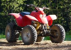 All Terrain Vehicle. A 4-Wheeler parked in the forest Royalty Free Stock Photography
