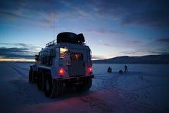 All-terrain vehicle on background of sunrise, winter season. royalty free stock image