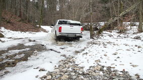 An all terrain vehicle driving through a small river stock video