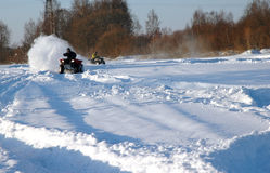 All terrain vehicle at winter. All terrain vehicle in motion at winter Stock Photography