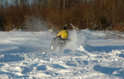 All terrain vehicle at winter Royalty Free Stock Image
