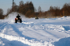 All terrain vehicle at winter. All terrain vehicle in motion at winter Stock Image