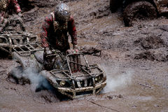 All-terrain vehicles in mud. A view of two all-terrain vehicles driving through mud as part of an off road endurance race Royalty Free Stock Photo