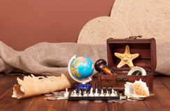 All travel:  globe, chess, old map and compass on brown. Royalty Free Stock Photo