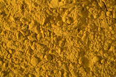 All turmeric. Turmeric, close up and lots of it. Lit with a fill light to even out the tones. Please see my other herb and spice images as well Stock Photography