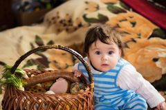 Little girl rejoices at the festive basket stock photos