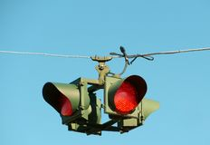All-way Stops  traffic lights hanging from wire Royalty Free Stock Photos