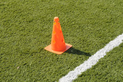 All Weather Pitch. Training cone on an all weather pitch Royalty Free Stock Image