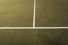 All-weather Tennis court close up, crossing of serve lines Royalty Free Stock Images