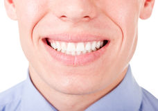 All is well!. Young man shows his teeth in a smile Stock Image