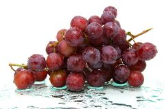 All wet. Wet red grapes on wet surface Stock Photo