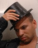 All Wet. Water runs over a man in a top hat Stock Photos