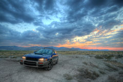 All wheel drive car ad. The one that can get you there an all wheel drive car under a beautiful sunset Royalty Free Stock Photography