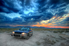All wheel drive car ad. The one that can get you there an all wheel drive car under a beautiful sunset Stock Photo
