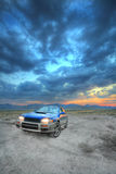 All wheel drive car ad. The one that can get you there an all wheel drive car under a beautiful sunset Royalty Free Stock Images