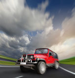 All-wheel drive car at the deserted highway Stock Photos