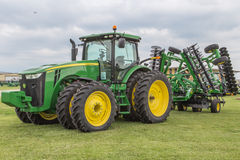 All-Wheel Drive John Deere 8285R Farm Tractor. A new modern all wheel drive model 8285R John Deere farm tractor with large disc attached stock photography