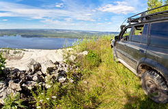 All-wheel drive SUV on the edge of a cliff Stock Photography