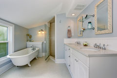 All white luxury master bathroom with vintage bathtub. All white luxury master bathroom with vintage bathub and tile floor Royalty Free Stock Images