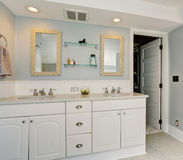 All white luxury master bathroom with vintage theme. Royalty Free Stock Image