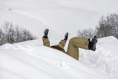 All in white, sliding on snow Stock Photography
