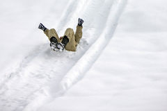 All in white, sliding on snow Royalty Free Stock Image