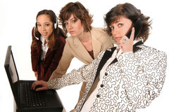 All working to help you. Communication via the computer and phone line these woman are all working to help you Royalty Free Stock Photos