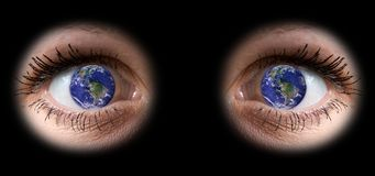 All the world in woman eye. Close up of a girl eyes with planet Earth into the pupil Royalty Free Stock Photos