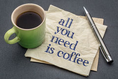 All you need is coffee - napkin with coffee. All you need is coffee - handwriting on a napkin with cup of coffee against slate stone background Royalty Free Stock Images