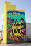 All you need is love by the Beatles painting. Stock Photo