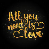 All you need is love golden handwritten lettering Royalty Free Stock Photo